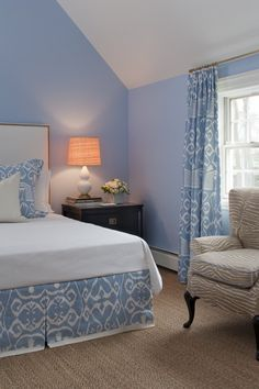 Wall color mimics the blue in the fabrics, other colors are neutral which keeps the wall color from being too much.