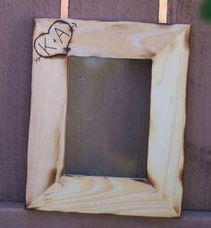 cute idea to burn-engrave our initials into plain wood frames