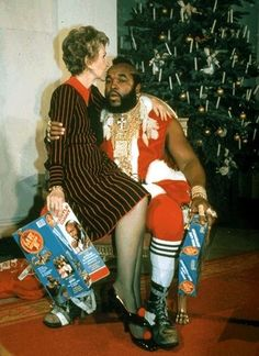 Nancy Reagan and Mr. T at a White House Christmas party in 1983