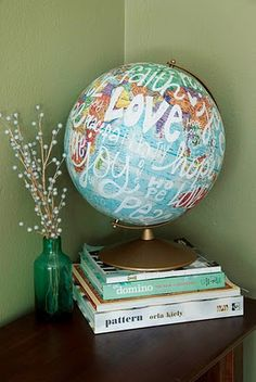 Globe with painted words - great idea with some travel books underneath