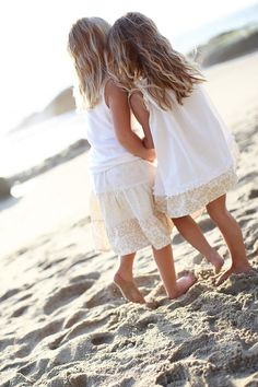 Summer and sisters in the sand