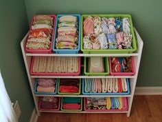 Use a toy or block storage rack to organize all the nursery fluff - handy! I plan to convert the one we have from the boys' toys to functional storage space and then stash it inside their closet!