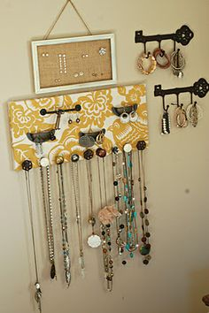 jewelry wall: fabric glued onto wood, with random knobs/pulls from craft or home store