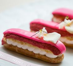 """Pink Desserts In Pierrot Gourmet - The hotel's street-level European bistro has created a specialty """"Rose Lychee Éclair."""" Additionally, pink fondant ribbons will be placed on several other desserts offered in the café. #PiP"""