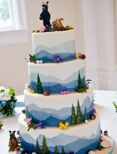 Mountain Horizon View Cake Do the bottom as a rectangle sheet cake, then 3 tiers of progressively smaller rounds?
