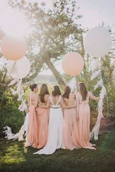 Helium balloons with trailing tassels make for stunning photos. Source: A Fist Full of Bolts. #balloons #tassels #DIY