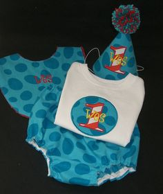 "$50 ""Every baby needs a keepsake outfit for that important first birthday, and I can't think of anything cuter for boys than a Sprinkles of Love Birthday Number tshirt, with a matching bib, diaper cover and party hat. The tshirt features baby's birthday number and name out of Michael Miller's Disco Dot Caribe. Hat is made from the same fabric, and topped with a pom pon that I handmake to ensure colors coordinate perfectly. The hat pictured here has an elastic neckstrap, but that can be replac..."