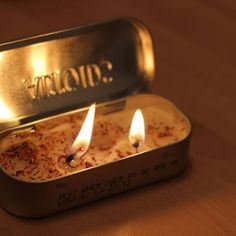 Homemade candles in recycled tins makes for a really unexpected (and fun!) gift this year!