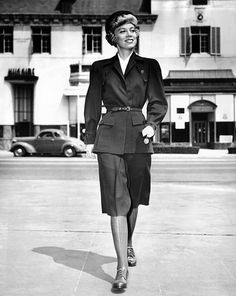 Wartime suit for women in defense work by Hollywood designer 'Irene' Lentz. The suit is made of olive drab wool, with dyed cotton stockings to match. Sept. 1, 1942. (CSU_ALPHA_1671) CSU Archives/Everett Collection