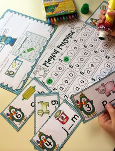 Winter themed literacy and math centers for Kindergarten! Like this one... use a bingo dabber to dab the missing short vowel sound.
