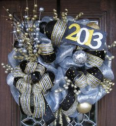 Deco Mesh New Year's Wreath Idea  ~would be cool to keep up for January