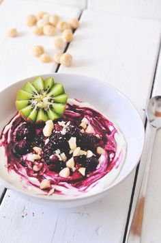 0% fat greek yogurt with sweet berries and a kiwi on top of spelt flakes