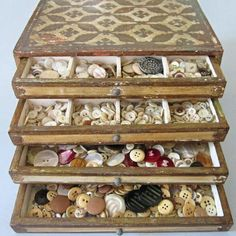 Antique Florentine 4 drawer chest filled with vintage buttons.