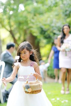 adorable flower girl in action // photo by Corinne Krogh // View more: http://ruffledblog.com/handmade-wedding-at-orcutt-ranch/