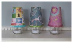 Baby Food Jar Crafts:  Baby Night Lights    Materials used in this baby food jar crafts tutorial:    •6 oz. baby jar    •LED tea lights    •8 oz. paper cups    •decorative paper or fabric    •ribbon or trim    •pipe cleaners    •glue