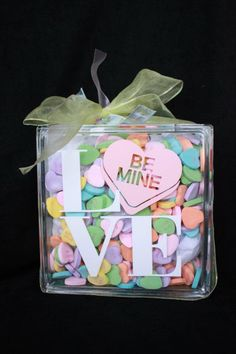 For Valentine's! Vinyl lettering on a glass block and then fill it with candy. Cute!!