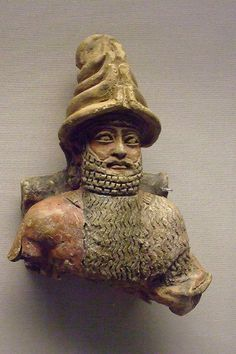 Painted unbaked clay statue of a Sumerian from a shrine at UR C.1800BCE