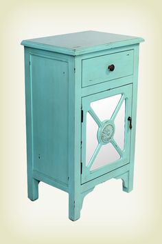 Give any room a touch of antique style with this teal distressed wooden cabinet!