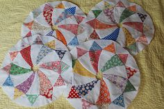 Hand pieced wheels by Nauvoo Quilt co.