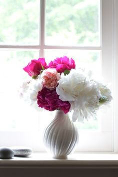 Roses and peonies from Frances Palmer's garden in a scallop bud vase