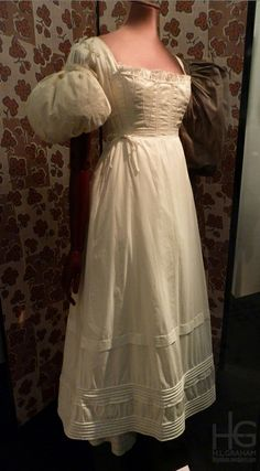 V&A White corded petticoat, stays and sleeve puffs, c. 1830s