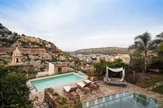 In Southern Sicily, a Baroque Retreat - This pool is one of the highest points on the property.  A glass dining table, lower right, sits atop a grotto used in medieval times as a synagogue.