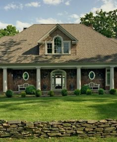 covered porch w/columns, minimal steps, dormer on hipped roof