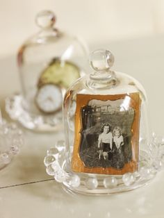 vintage photos and family heirlooms under a cloche