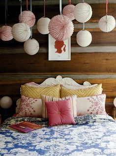 Girls Room: Silhouette above the bed, paper lanterns, blue/pink/yellow bedding, ornate twin bed.