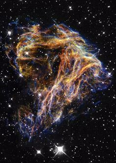 Celestial Fireworks - Hubble by Deep Space Photography - Resembling the puffs of smoke and sparks from a summer fireworks display in this image from NASA's Hubble Space Telescope, these delicate filaments are actually sheets of debris from a stellar explosion in a neighboring galaxy.
