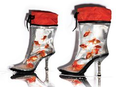 No, they're not actual fish tanks. They are PVC Boots by Miu Miu, just styled with water and goldfish for V Magazine's article, REBEL STYLE.