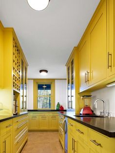 HGTV Remodels energetic yellow kitchen, Kitchens with Color #inspiration #ideas white kitchen cabinets, yellow kitchen, painted kitchens, colorful kitchens, galley kitchens, modern kitchens, kitchen ideas, kitchen designs, painted kitchen cabinets