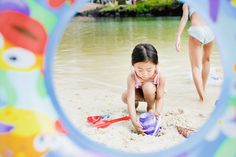 Shoot through an inner tube at the beach or the pool to frame your subject with a colourful border.