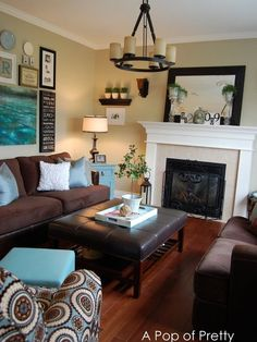 Living Room-Aqua/browns / I love the fireplace - I actually have a lot of these colours going on in my family room - may update a few pieces for spring.
