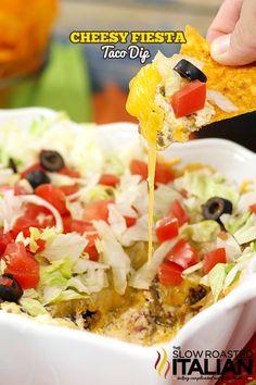 Cheesy Fiesta Taco Dip from theslowroateditalian.com #appetizers #recipe @slowroasted