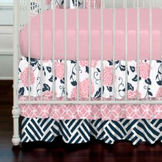 """Crib Bedding Skirt in Navy and Coral Ruffles by Carousel Designs.  Layer up with our flowing three-tiered crib skirt, perfect for hiding unsightly crib hardware and for putting the final touch on your crib. Finished length approximately 18 inches. Fits standard cribs using mattresses measuring approximately 28"""" x 52""""."""