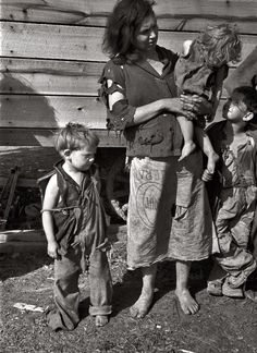 Mother and nine children living in a field on U.S. Route 70 near the Tennessee River during the Depression - 1936.  Photo by Carl Mydans for the Farm Security Administration