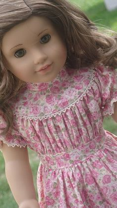 Pink roses doll dress with yoke.