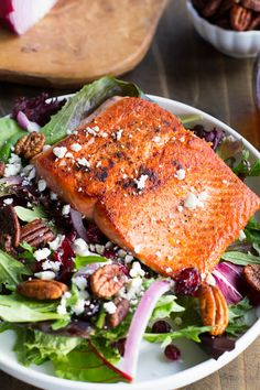 Seared Salmon with Mixed Greens over Dried Cranberries, Feta, and Candied Pecans
