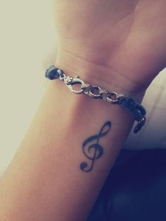 Treble clef wrist tattoo