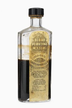 "Bottle of blood purifying mixture, united kingdom, 1880-1930: diluted with water, a tablespoon of this mixture of iodised sarsaparilla was recommended to be drunk by adults three times a day after meals. sarsaparilla is a vine-like plant native to north america and the west indies and has a long history as a component of medicinal tonics, especially blood purifiers. the mixture promised to clear the skin and purify the blood and claimed to be an ""excellent spring and autumn medicine""."