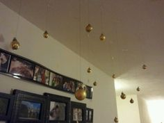 Christmas ornaments on the ceiling. All you need is string, ornaments and white duck tape.