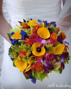 For Bridesmaids with a little less yellow and green, more color perhaps. Bright bouquet includes yellow mini calla lillies, orchid, roses, delphinium and other mixed flowers. Great for a beach wedding in South Florida
