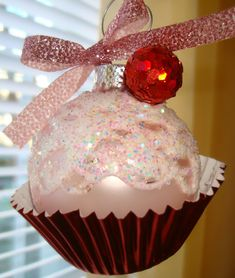 Cupcake Christmas Ornament DIY use fun decorative cupcake liners could use small ornaments and let the kids put them together. Use puff paint/glitter paint to draw designs or write names on them. Could even use as name tags. at the holiday table. Color coordinate w table setting. Nice take home treat