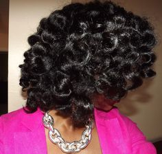 Twisted bantu knot out on blown out natural hair