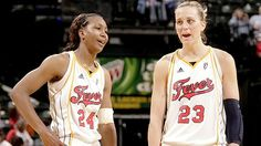 Indiana Fever's Tamika Catchings and Katie Douglas