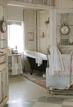 rustic french country farmhouse bathroom with black and white claw foot tub