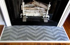 painted fireplace floor tile.  two great things about this diy project: 1. would hide hideous forest green faux marble, 2. is a tribute to one of my fav patterns, herringbone.