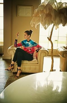 Gorgeous look for fall. The print sweatshirt with jogger pants and show stopping sandals, go well together.
