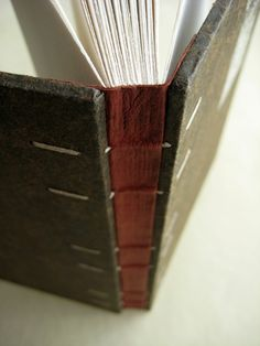 glued leather-covered coptic book by paperiaarre